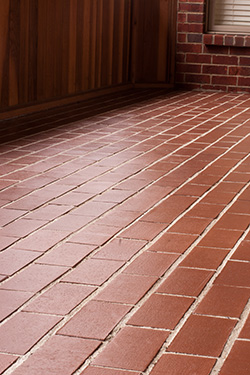 Wet Look Sealer Applied To A Brick Patio.