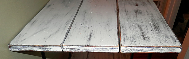 Close Up Photo Of Varnished Wood Shelves After Being Distressed And Painted