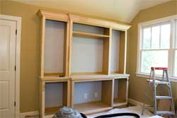 Unfinished bookcase made of MDF, medium density fiberboard.