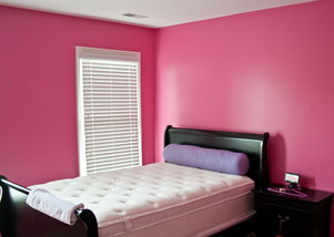 Photo of bedroom walls painted with Sherwin-Williams color - Hibiscus
